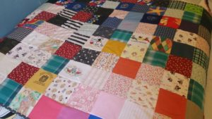 close up of Charlotte's memory patchwork quilt