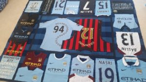Laying out & pinning Max's Man City football shirt patchwork quilt