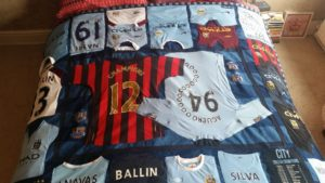 Max's finished football shirt quilt