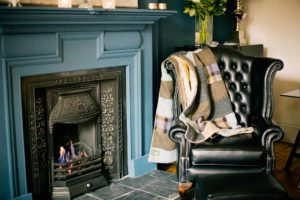 Gentleman's smoking room with Sunshine yellow velvet and subtle blues, browns and greys Harris Tweed patchwork quilt £355.00