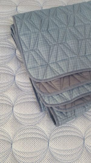 Lighter weight reversible quilted shirt quilts available in two contemporary designs and colourways.