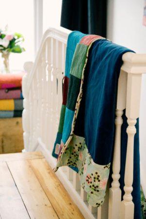 Sumptuous Royal Blue velvet encircled by Hemlock design on reverse of Brights Harris Tweed patchwork quilt.