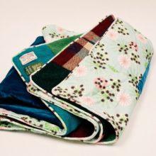 Hemlock printed fabric by Annabel Perrin on the reverse of Brights Harris Tweed patchwork quilt.