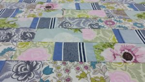 Detail of Cool Blues John Lewis and Designers Guild Summery Quilt.