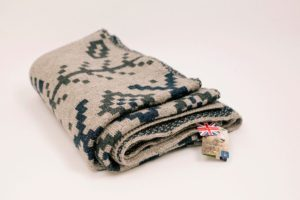 My British Woollen blankets are available in a Geometric 3-D Tumbling Block design or, as seen here BIG Fair Isle knit design.