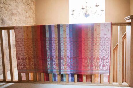 Folklore fabric 200cm length Bird&leaf motif in Rhubarb colourway.