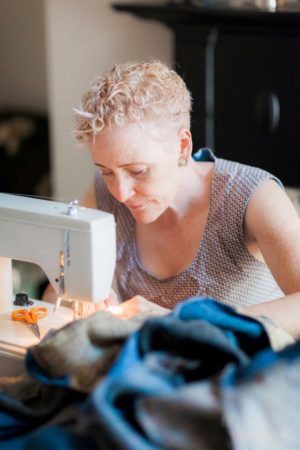 Lisa stitching a bespoke Harris Tweed super king size quilt