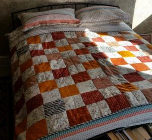 Emma asked me to stitch a quilt for a friend using some cherished curtains made by their mother.
