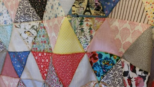 Close-up of triangular patchwork quilt commission.