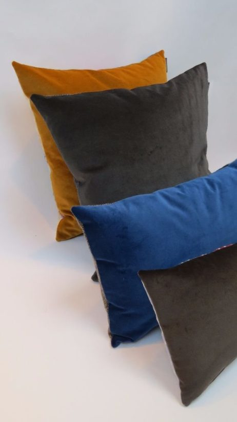 Folklore cushions backed in British velvet