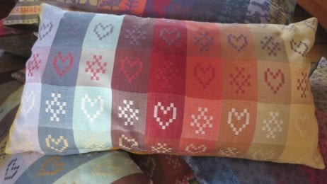 The heart and cross pattern in the Folklore Fabric metered lengths can be found in designs throughout our everyday lives, in textiles, interiors and also in architecture so they have a reassuring familiarity to them.