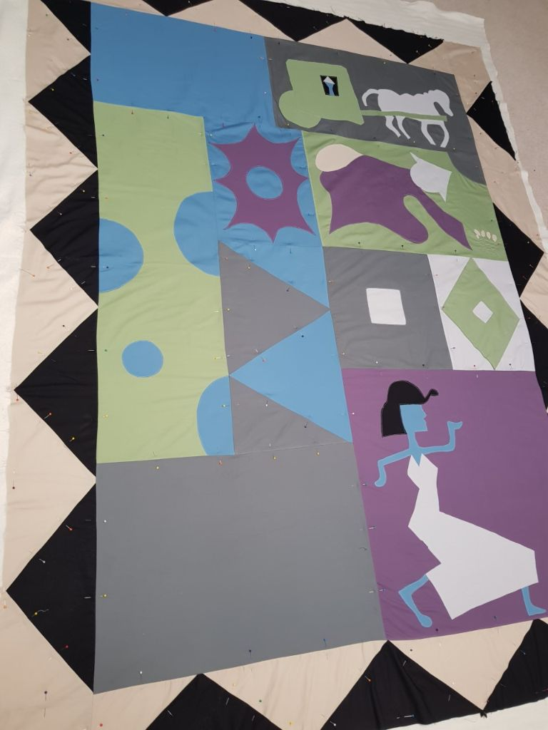 Pinning quilt layers together