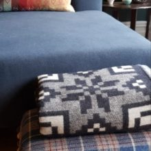 Carbon Blue and Ash silver are the contemporary colourways for this wool throw, so you can flip this reversible blanket to suit your interiors and/or your colour mood.